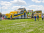 At 143-feet, the Toxic Rush Obstacle Course is the perfect centerpiece inflatable for your event in Minnesota.  Here is our set-up at the Andover Family Fun Fest.  From front to back, the first piece is the 45' Atomic Rush, then the Nuclear-themed rock-cl